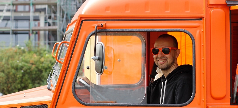 A truck driver smiling