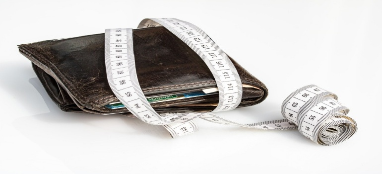 wallet and a measuring tape