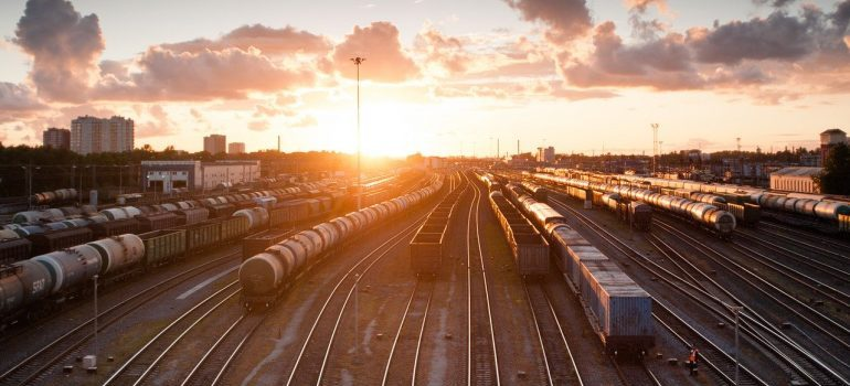 Trains, sunset, and tracks.