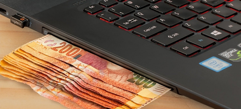 Money inserted into a laptop