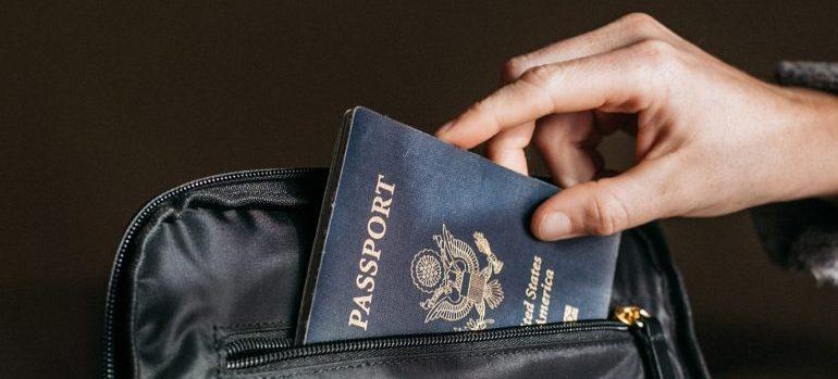 putting a passport in a bag