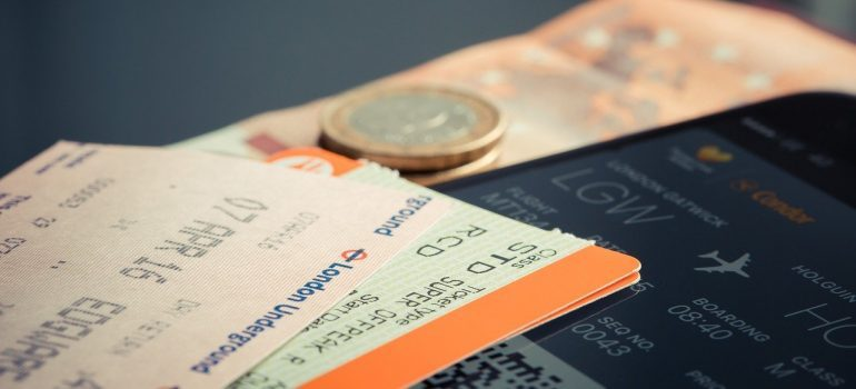 Plane tickets to buy when moving to Melbourne from NYC.