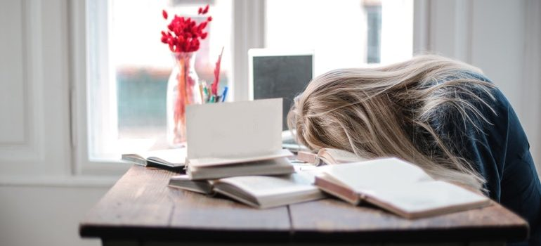 Woman failing to avoid post-moving exhaustion.