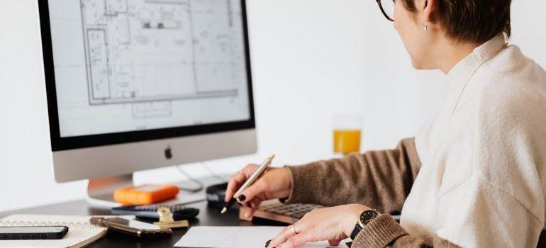 A woman looking at a monitor.