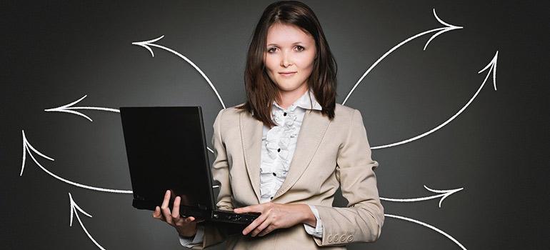 A woman holding a laptop