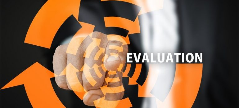 A man pointing at the word evaluation.