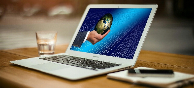 a computer screen showing hand holding a globe