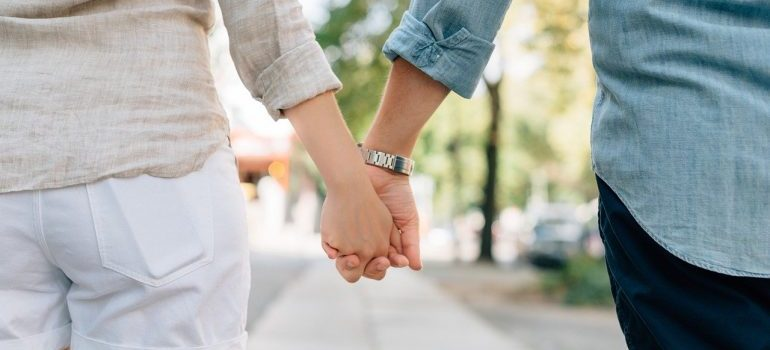 A woman and a man holding hands.