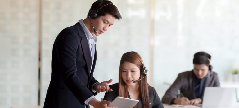 two colleagues in modern tech support office