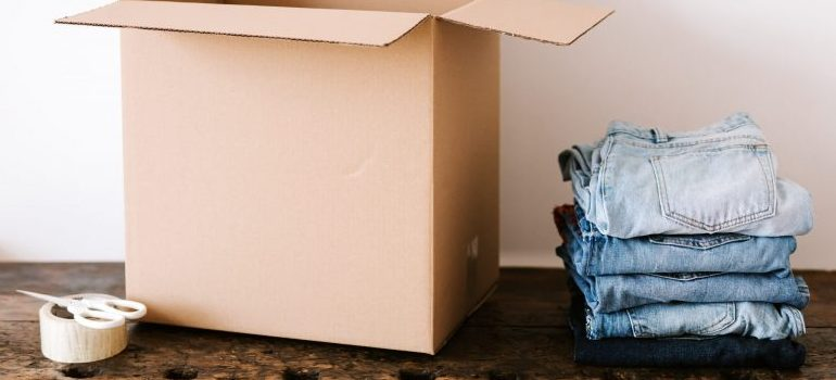 moving box, packing tape and jeans