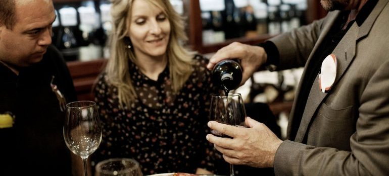 People drinking wine after moving to Barcelona from NYC