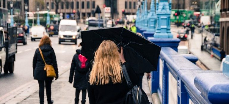 A woman walking with an umbrella.