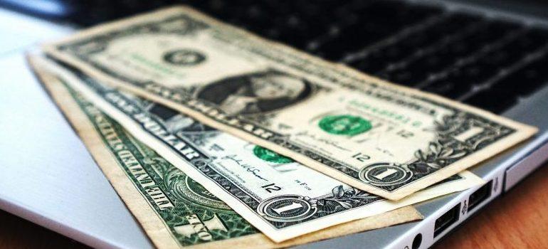 US-dollar-bills-on-the-laptop