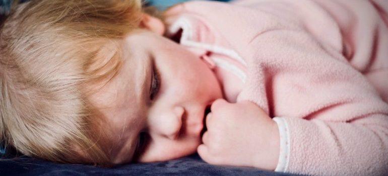 Toddler in pink pajamas sleeping.