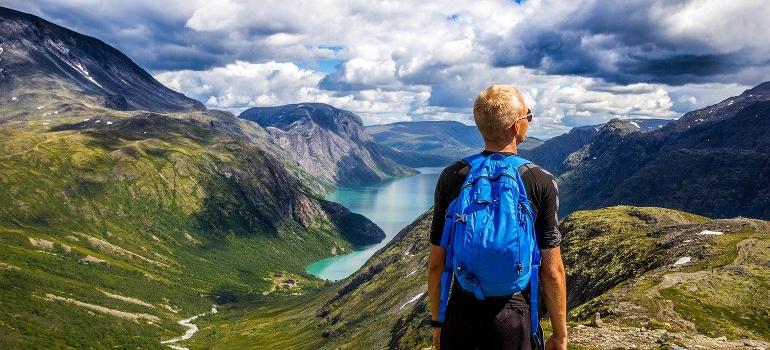 a man looking at fjord
