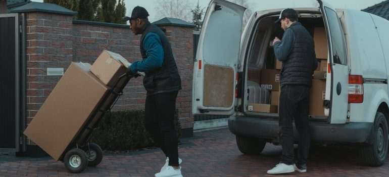 two males unloading a van