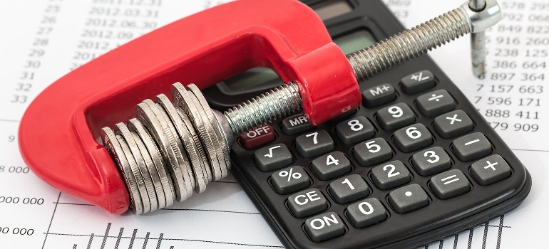 calculator and money in a clamp