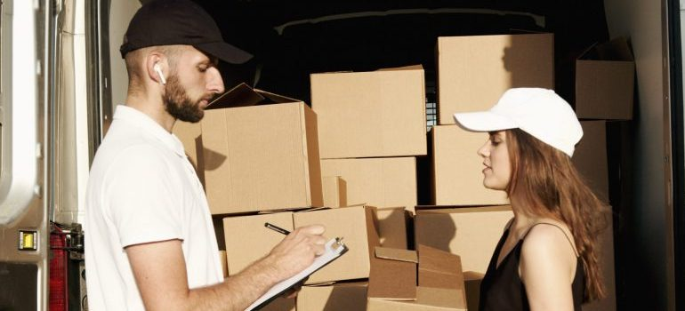 two people loading a moving van