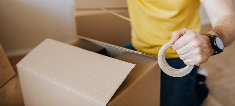 Man taping a box