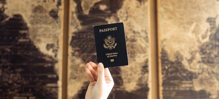 hand holding a US passport