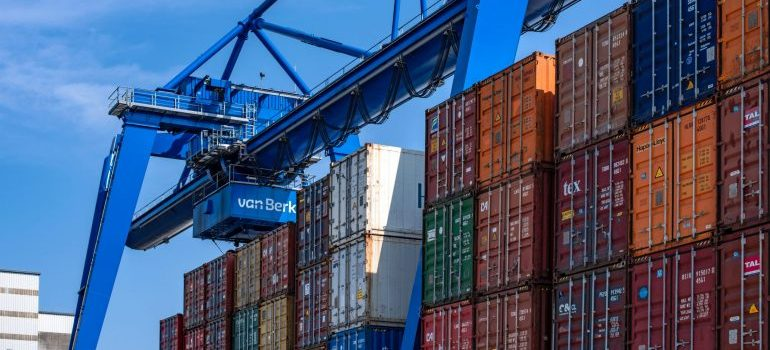 cargo containers under a crane