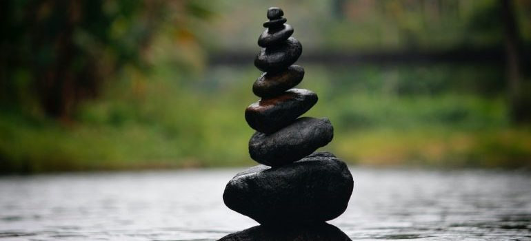 International shipping mistakes to avoid are like balancing tower of rocks in the water