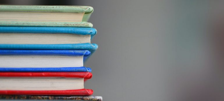 a stack of books representing a way to pack your personal library for international move with ease