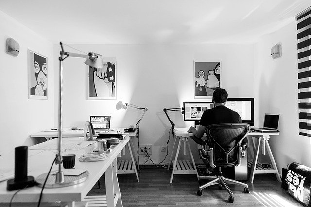 a man working in the office at the computer