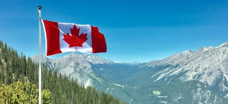 canadian flag with mountains in the backround