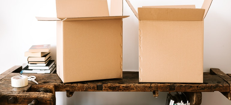 Two cardboard boxes on table