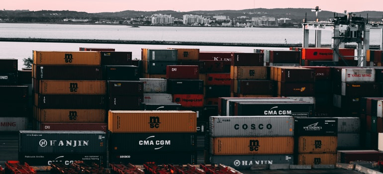 Shipping containers stocked on bay