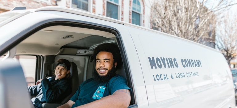 Two guys sitting in a moving van