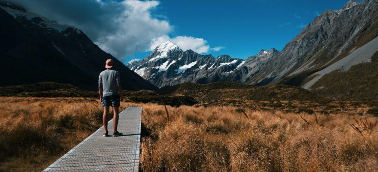 a man standing in nature after relocating to New Zealand