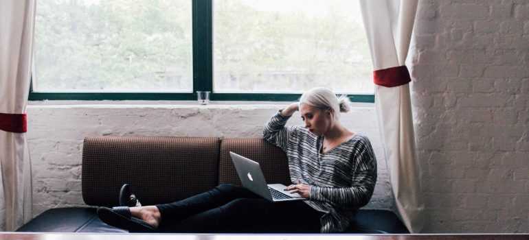 a woman reading on laptop