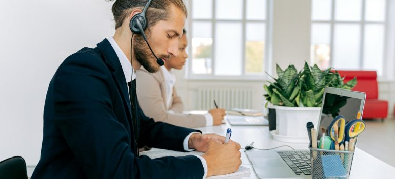 a man with headphones working from office as a representation of why connectivity in a global manufacturing footprint is importnat
