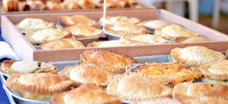 a plethora of meat pies in baskets