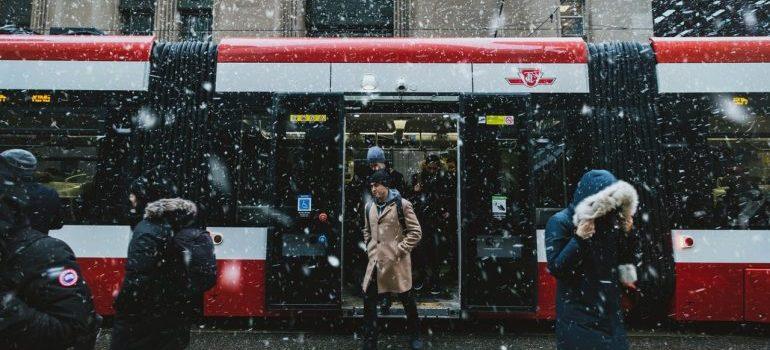 People walking near train