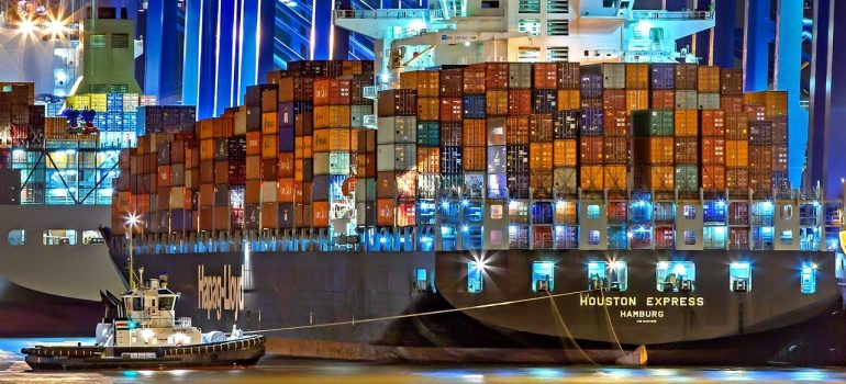 a load of containers on a ship