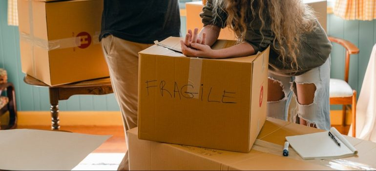 a couple packing fragile content