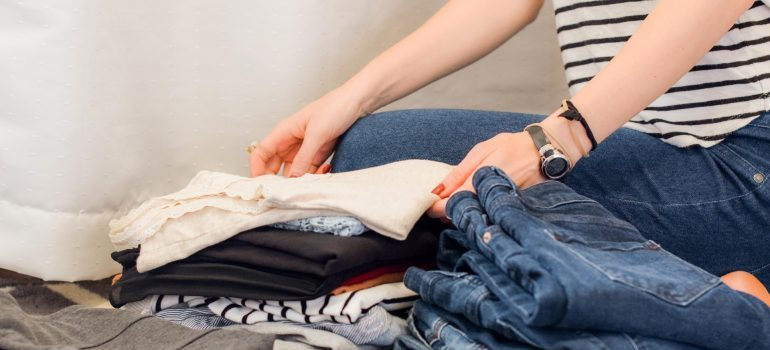 woman sorting clothes