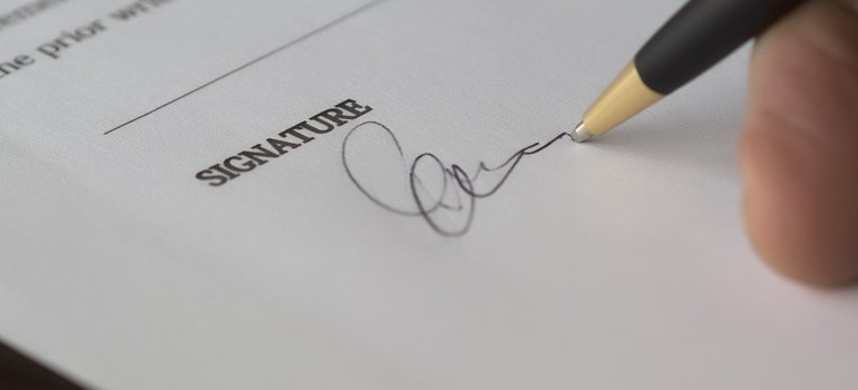 a person signing a moving contract