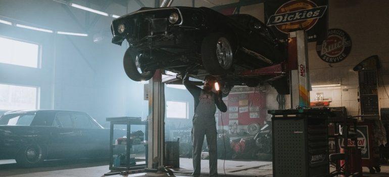 a mechanic mending a car