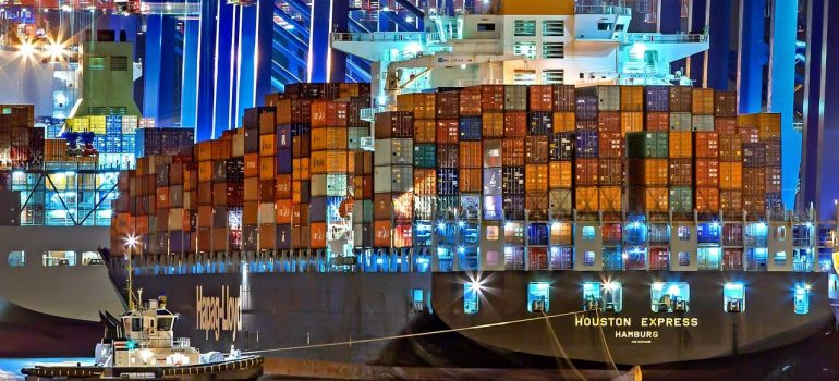 a ship carrying plenty shipping containers