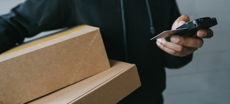 Person holding packages