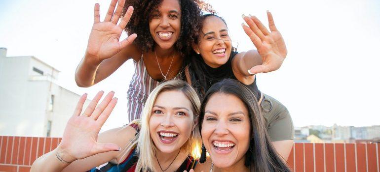 Four friend smiling